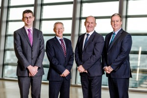 LHS: Richard Candy, Murray Fairclough (legal services director), Ian Lewis, Graham Small (partner)