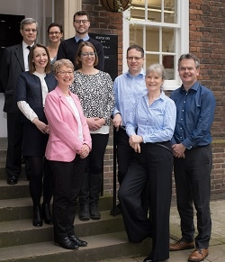 The Postlethwaite Solicitors team, with Robert Postlethwaite on the right