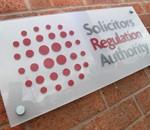 SRA logo on brick wall